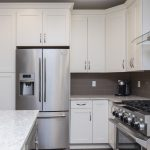 white kitchen with white granite on article about cleaning and maintaining your granite counter tops