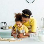 Family baking on modern countertops
