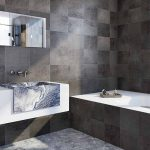 Black granite tiles and granite sink in modern home improvement bathroom project