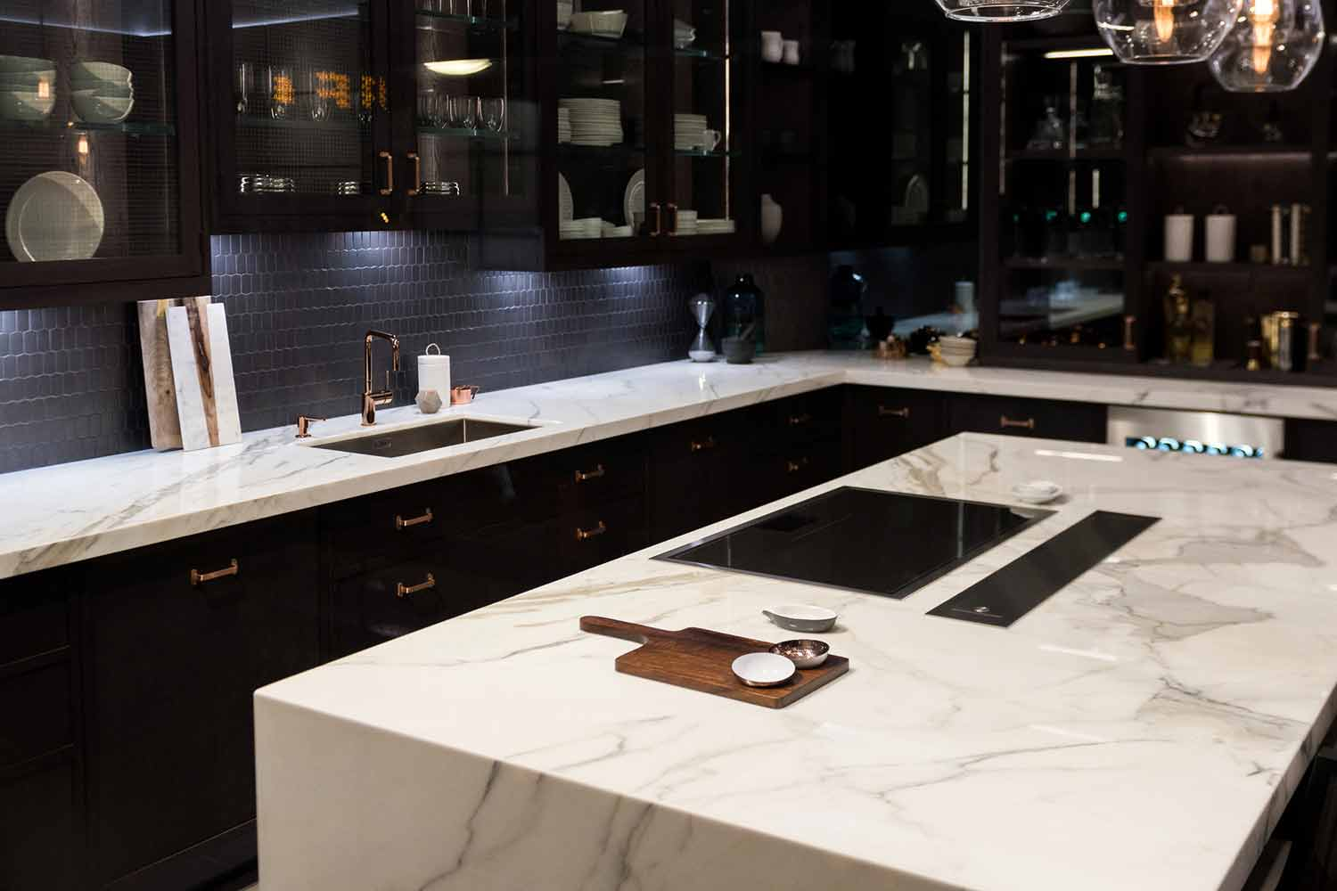 Black kitchen cabinets with marble granite countertops