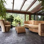 Comfortable lounge set in conservatory with natural stone granite floor