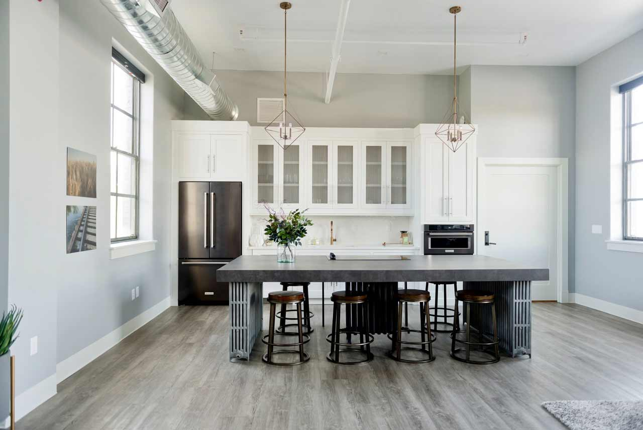 mitered edge countertop profile. this image shows a kitchen with a large charcoal countertop.