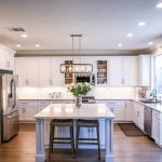 """beautiful kitchen with a white aesthetic showing off quartz countertops for the blog, """"What is Quartz"""""""