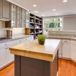 Picture of modern kitchen with granite countertops for the blog how to seal granite countertops.