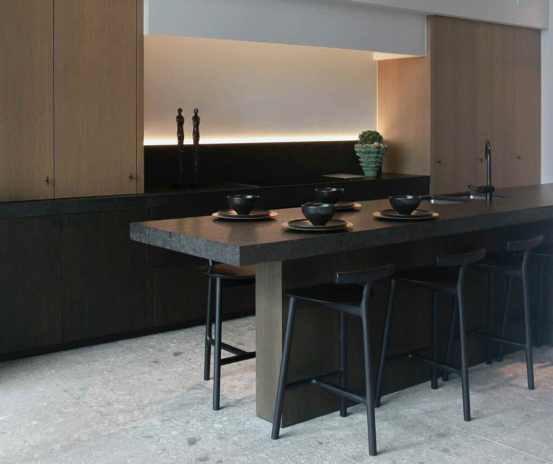 Picture of modern kitchen with dark honed granite countertops.